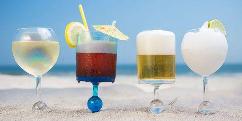 Drink, Champagne cocktail, Cocktail, Alcoholic beverage, Distilled beverage, Blue hawaii, Cocktail garnish, Non-alcoholic beverage, Wine cocktail, Fizz,