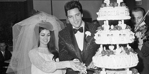 Elvis and Priscilla Presley cut their wedding cake