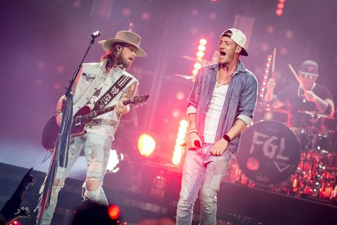 Musical instrument, Musician, Entertainment, Event, Performing arts, Music, Stage equipment, Microphone, Hat, Band plays,