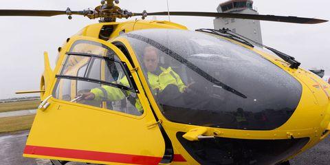 Helicopter, Mode of transport, Rotorcraft, Transport, Yellow, Aircraft, Aviation, Helicopter rotor, Glass, Windshield,
