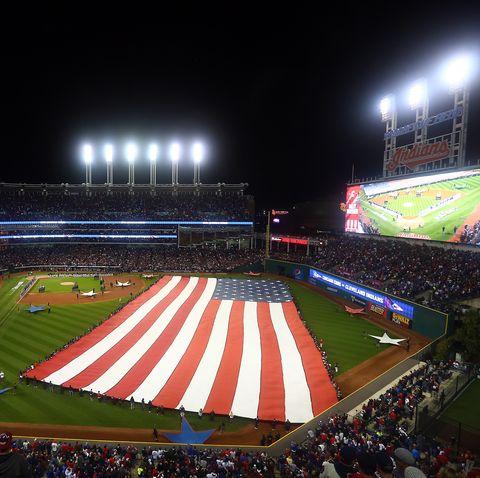 large american flag on baseball field