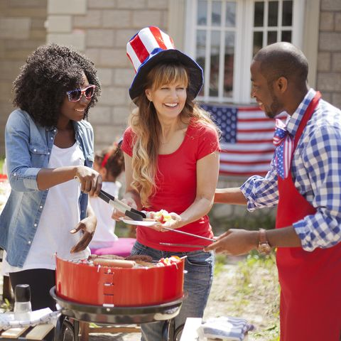 people around on a grill at a 4th of july barbecue