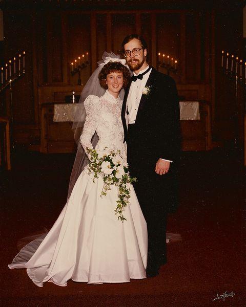 Gown, Bride, Wedding dress, Bridal clothing, Dress, Facial expression, Formal wear, Bridal accessory, Bridal veil, Ceremony,