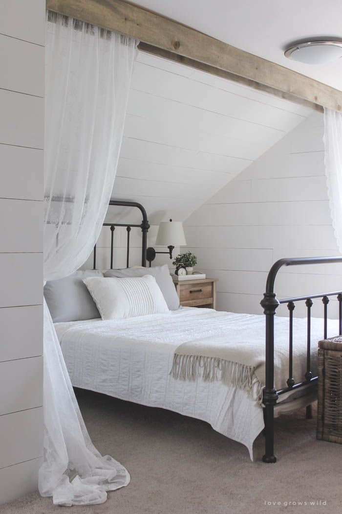 Vintage style meets modern rustic decor in this serene bedroom with #shiplap #woodbeams and #neutralinterior
