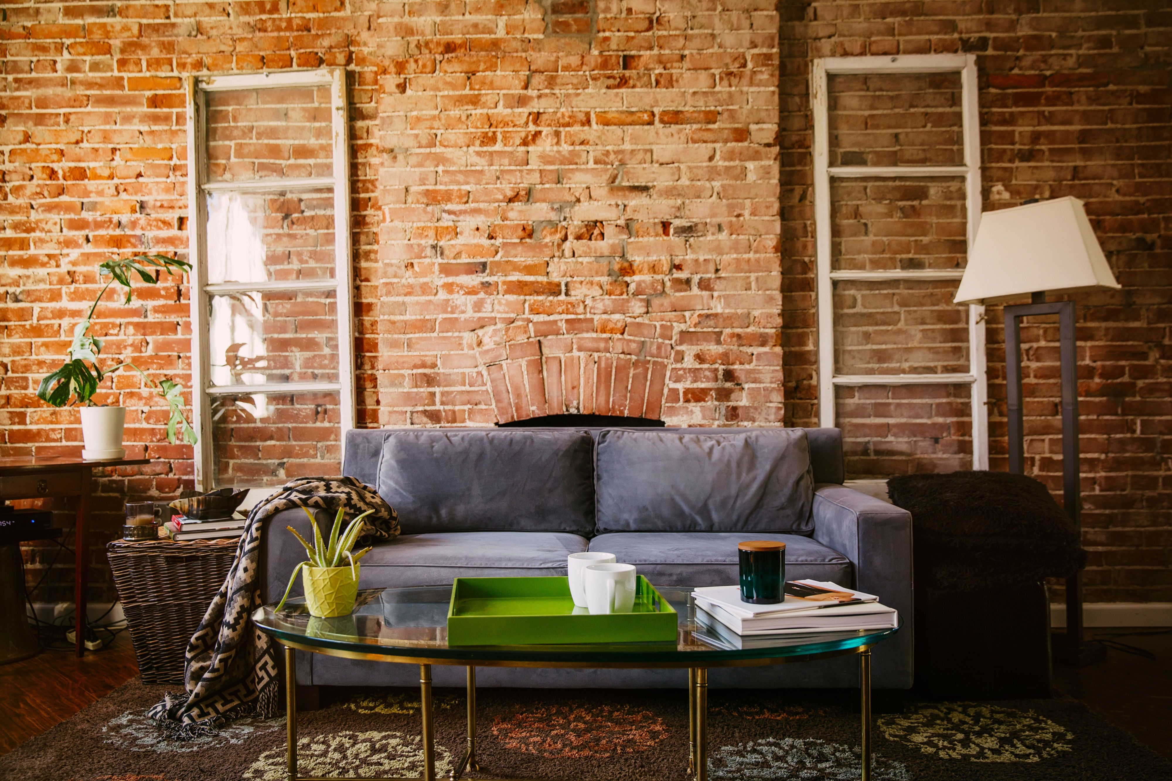 pros cons of exposed brick how to care for brick walls rh countryliving com interior brick walls painted white brick interior walls ideas