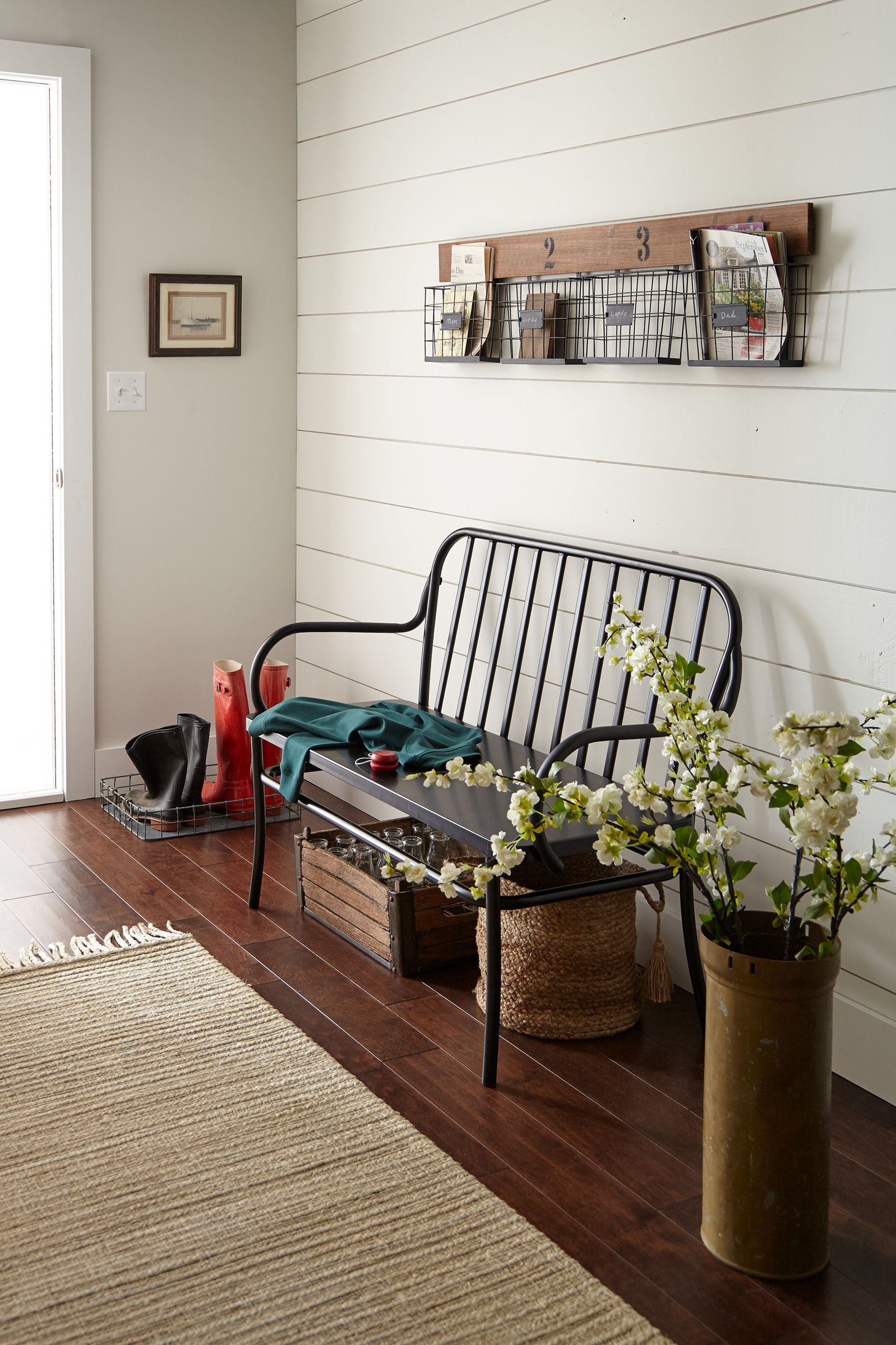Farmhouse style entry with black bench, shiplap, rustic decor. Paint color is Kilz Shiplap.