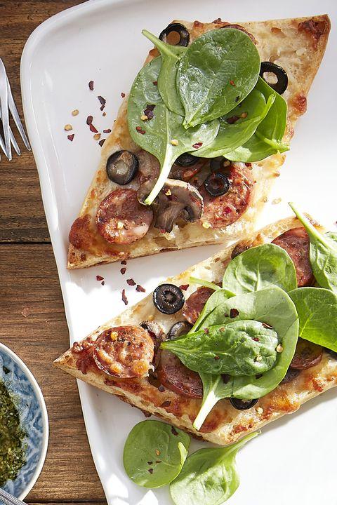 sausage mushroom black olive white pizza