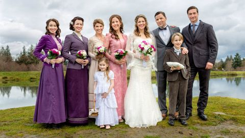 Clothing, Smile, People, Dress, Bridal clothing, Event, Trousers, Coat, Photograph, Purple,