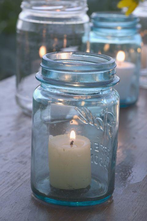 Mason jar, Lighting, Candle, Glass, Flameless candle, Lantern, Candle holder, Tableware, Interior design,