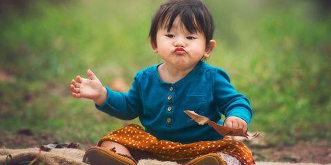 Child, Sitting, Toddler, Musical instrument, Grass, Hand, Child model, Smile,
