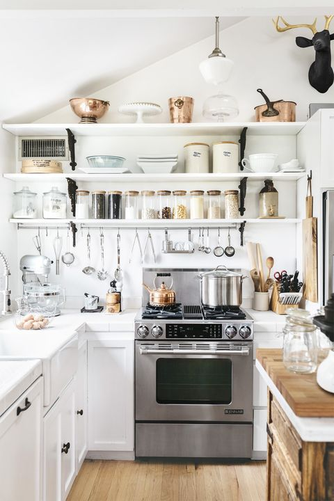 24 Best White Kitchens - Pictures of White Kitchen Design Ideas Ideas For Decorating Above Kitchen Stove Backsplash on cabinets above stove, lighting above stove, backsplash behind stove, tile mural above stove, subway tile above stove, decorative tile above stove, microwave above stove, accent tile above stove,