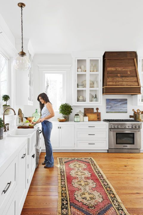 24 Best White Kitchens - Pictures of White Kitchen Design Ideas Kitchen Dark Cabinets Below White Above on white kitchen crown molding, white kitchen gray, white cabinets design, walnut kitchen cabinets, white kitchen granite, white kitchen wall color, white kitchen tile, black kitchen cabinets, white kitchen travertine floors, white kitchen white, white kitchen modern, white kitchen wood flooring, white kitchen breakfast nook, white kitchen vaulted ceilings, oak kitchen cabinets, country kitchens with white cabinets, white kitchen double oven, hardwood floors dark cabinets, green dark cabinets, white kitchen backsplash,