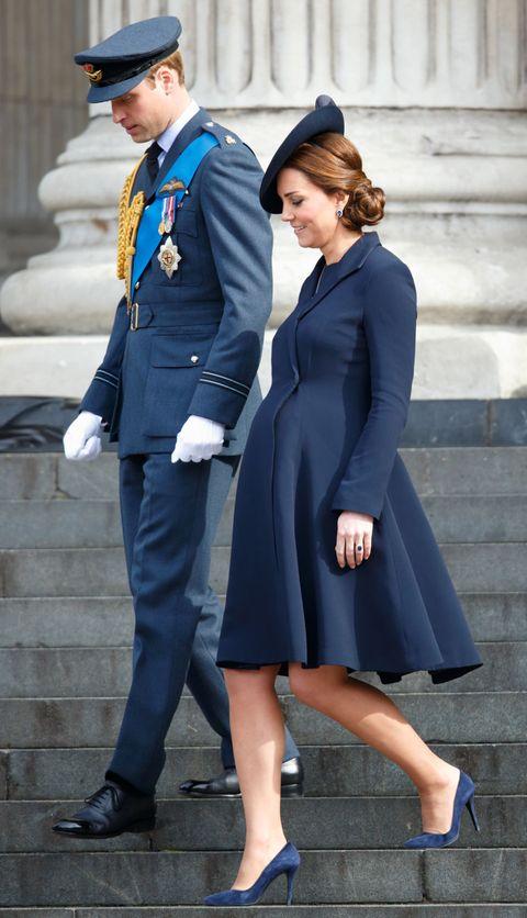 Clothing, Street fashion, Uniform, Fashion, Cobalt blue, Coat, Standing, Dress, Suit, Formal wear,