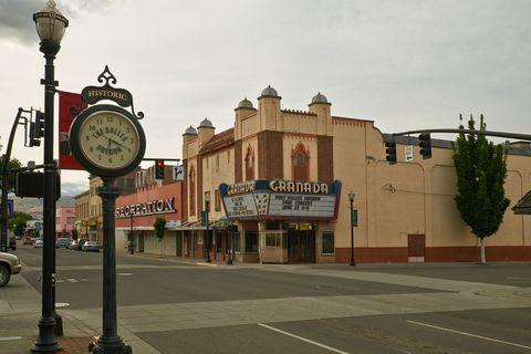 Town, Landmark, Transport, Clock, Building, Architecture, Urban area, Tree, City, Street light,