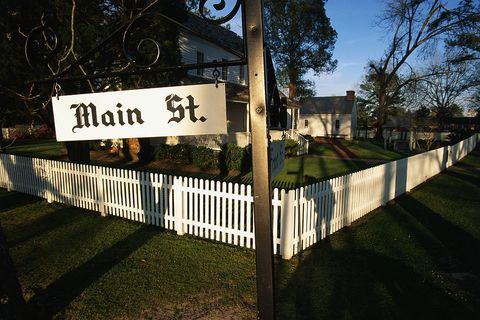 Fence, Property, Tree, Sky, Home fencing, Grass, Signage, Architecture, Street sign, House,