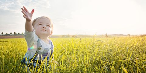People in nature, Photograph, Grass, Facial expression, Yellow, Child, Grassland, Green, Sky, Meadow,