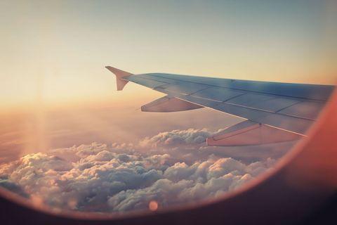 Air travel, Sky, Cloud, Airline, Wing, Atmosphere, Daytime, Airplane, Flight, Flap,