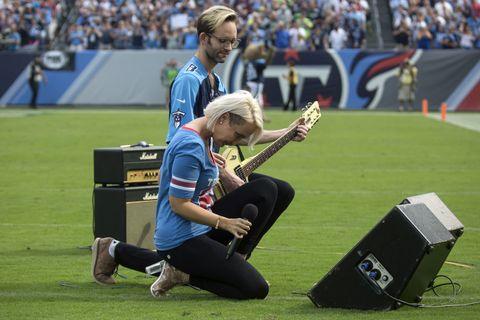 Grass, Stadium, Musician, Sport venue, Player, Team sport, Musical instrument, Woodwind instrument, Sports, Lawn,