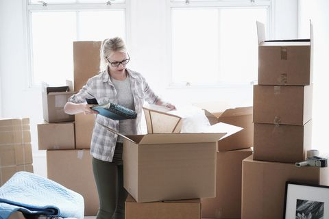 Cardboard, Carton, Package delivery, Box, Relocation, Shipping box, Desk, Paper product, Office supplies, Furniture,