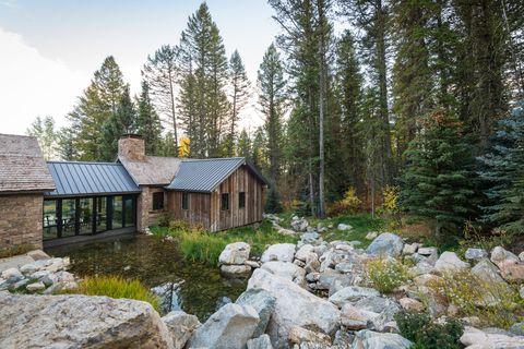 Property, Natural landscape, House, Home, Cottage, Wilderness, Real estate, Tree, Estate, Rock,