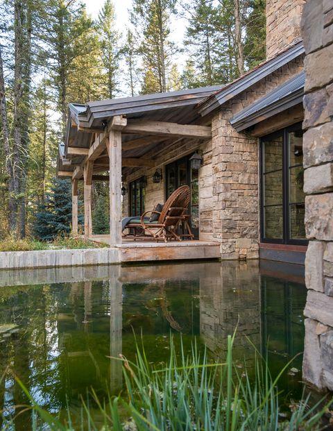 House, Property, Natural landscape, Log cabin, Tree, Cottage, Building, Home, Reflection, Pond,