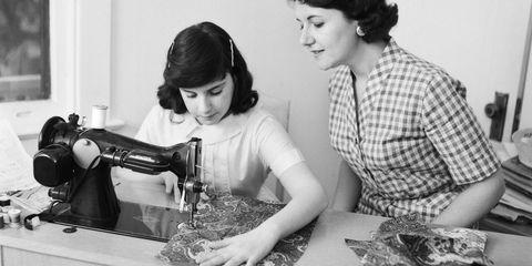 Photograph, Sewing machine, Typewriter, Dressmaker, Snapshot, Office equipment, Photography, Black-and-white, Room, Child,