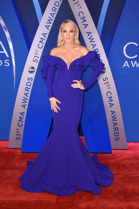 Cobalt blue, Red carpet, Electric blue, Carpet, Clothing, Dress, Blue, Hairstyle, Gown, Shoulder,