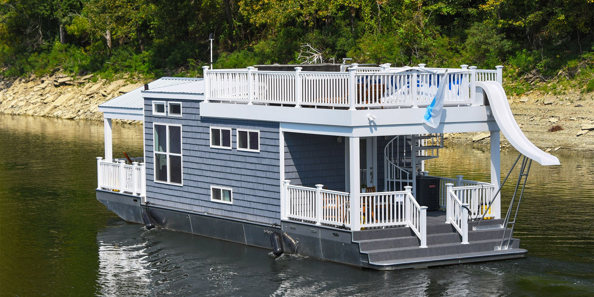 This Tiny Houseboat Is The Coolest Thing To Float On Water