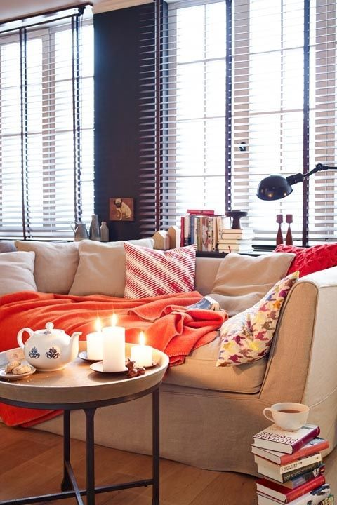 Living room, Interior design, Room, Furniture, Window covering, Red, Window treatment, Orange, Curtain, Couch,