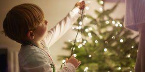 how to hang christmas lights boy stringing lights