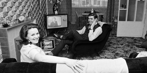Celtic footballer John Hughes at home with his wife, 1968