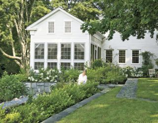 Restored Connecticut Home With White Garden and White Siding