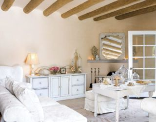white living room with beams