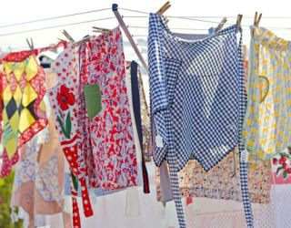vintage aprons on a clothesline