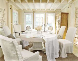 white dining table and chairs with white slipcovers