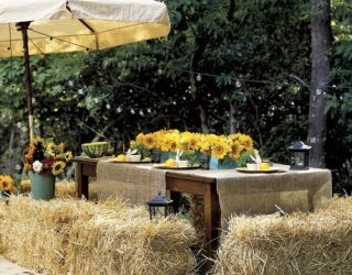table set outdoors with bales of hay