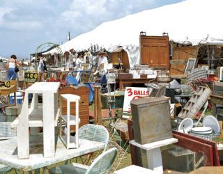 a variety of antique furniture at an outdoor market