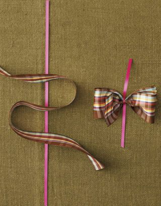 pink and plaid ribbons being made into a bow