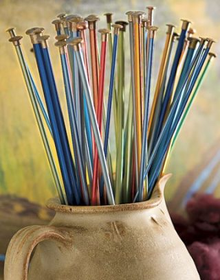 pitcher of colorful knitting needles