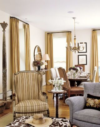 armchairs and an ottoman in front of dining table