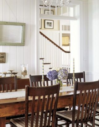 white dining room with wood dining table and chairs
