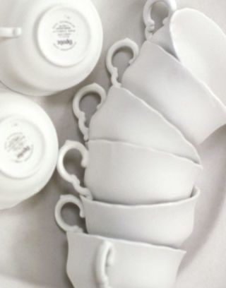 white teacups stacked on their sides