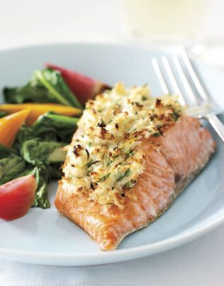 cooked salmon on a plate with fresh vegetables