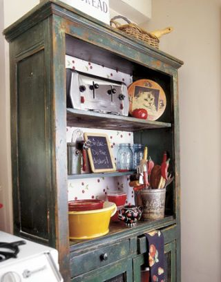 Cherry-Print Wallpaper Refreshes Vintage Cabinet