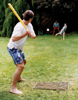 Playing whiffle ball