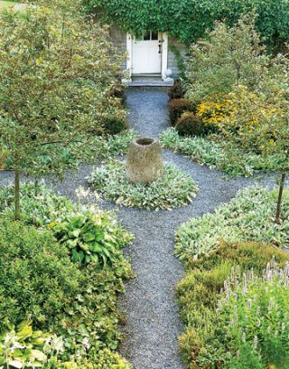 Gravel path leads through the garden