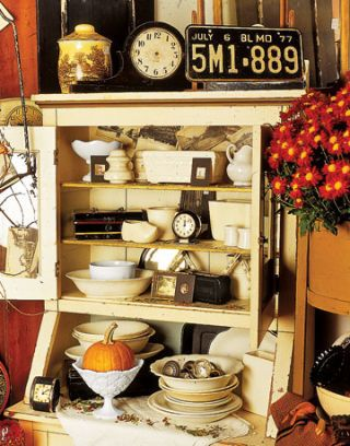 shelf with antiques and knick knacks