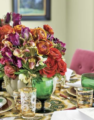 floral centerpiece on a table with green goblets