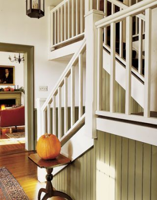 white staircase with green trim