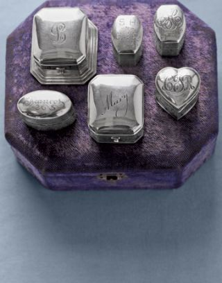 monogrammed silver ring boxes on a purple velvet box